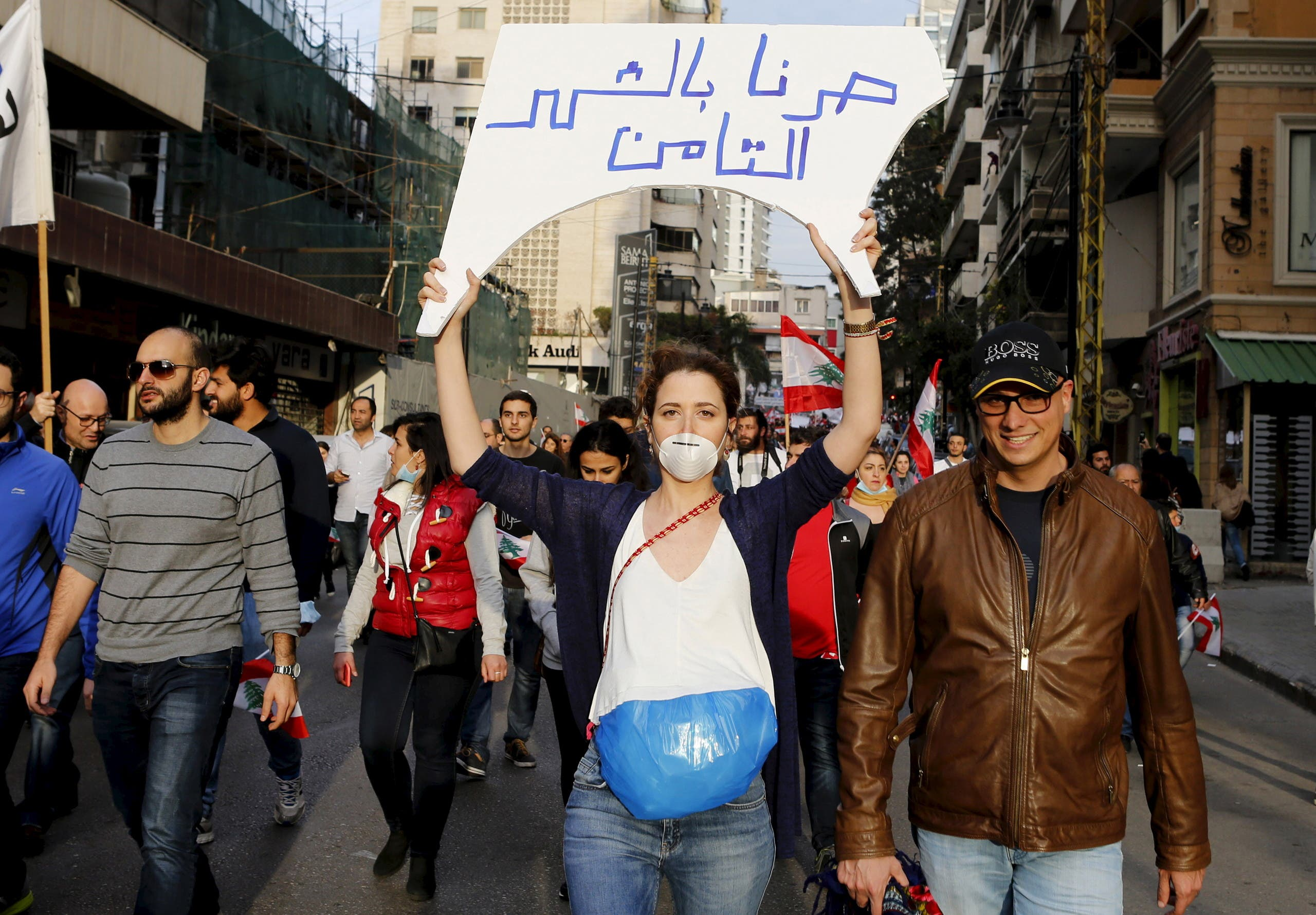 A protester, wearing a garbage bag and holding up a sign, takes part in a protest against what demonstrators say is the government's failure to resolve a crisis over rubbish disposal in Beirut, Lebanon March 12, 2016. (Reuters)