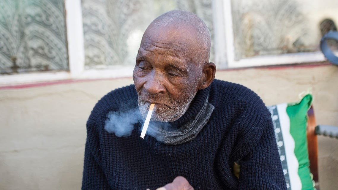 Fredie Blom enjoys a cigarette as he celebrates his 116th birthday at his home in Delft, near Cape Town. (Reuters)