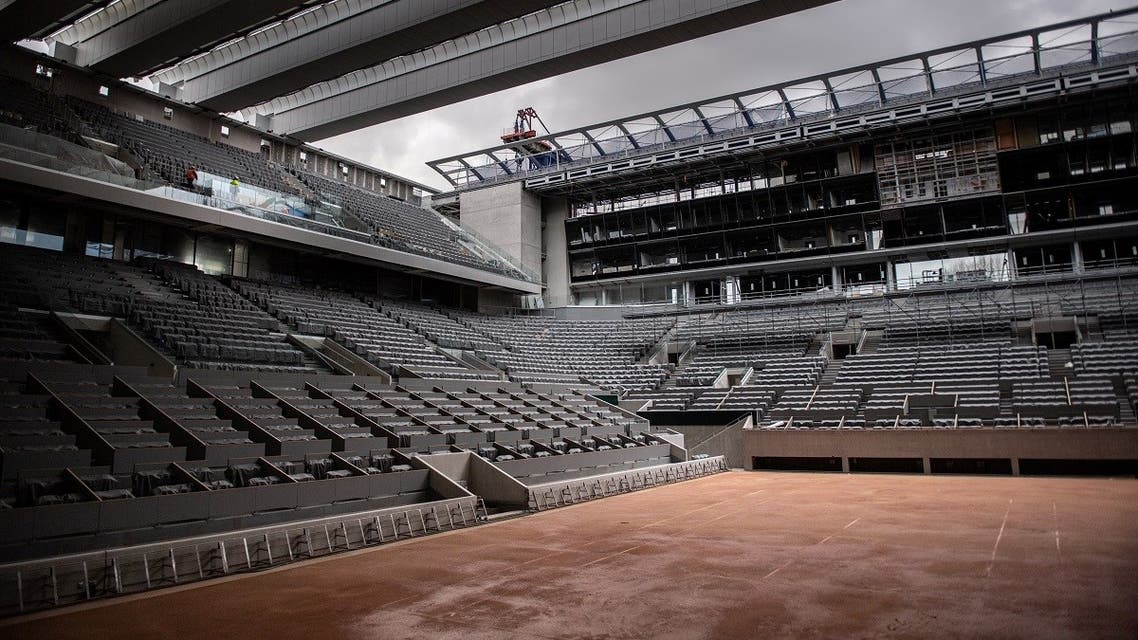 This picture taken on February 5, 2020 at the Roland Garros stadium in Paris shows the construction work of the newly built roof of the Philippe Chatrier central tennis court. (AFP)