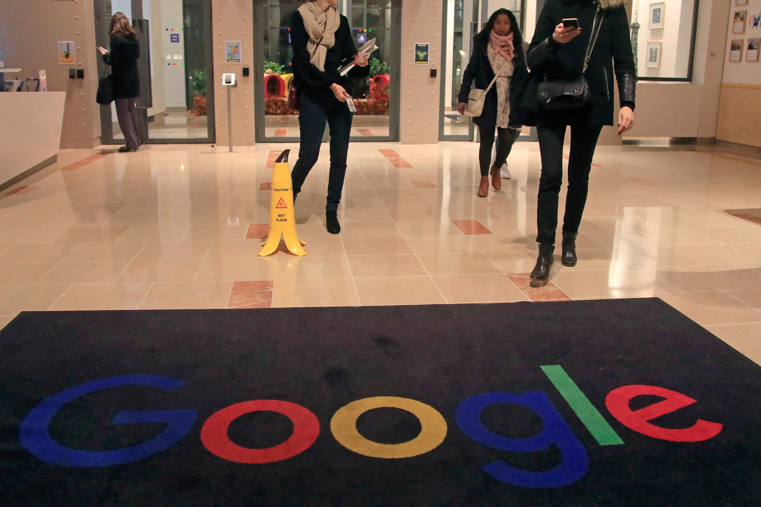Google employees walks out of the entrance hall of Google France in Paris. (File Photo: AP)