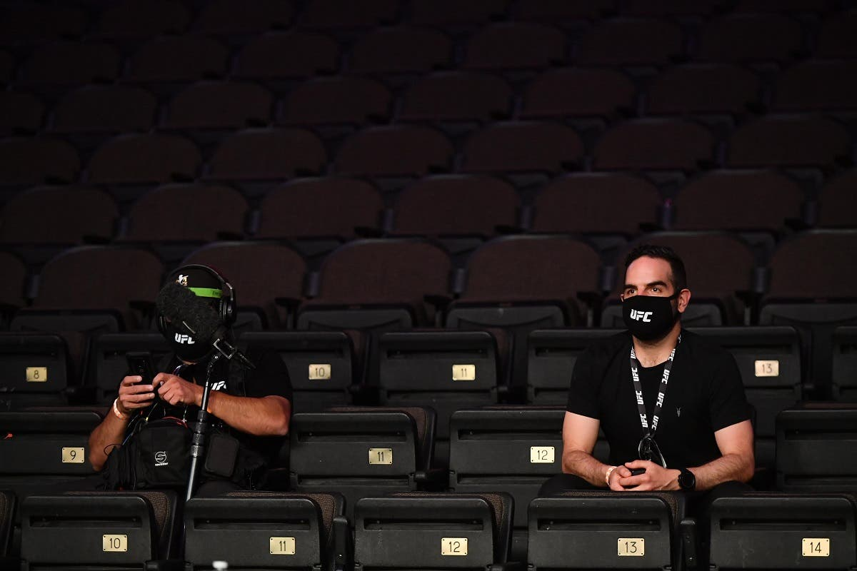 Medemia members work in masks and with proper social distancing during the fight between Aleksei Oleinik (red gloves) and Fabricio Werdum (blue gloves) during UFC 249 at VyStar Veterans Memorial Arena. (Jasen Vinlove/USA TODAY Sports)