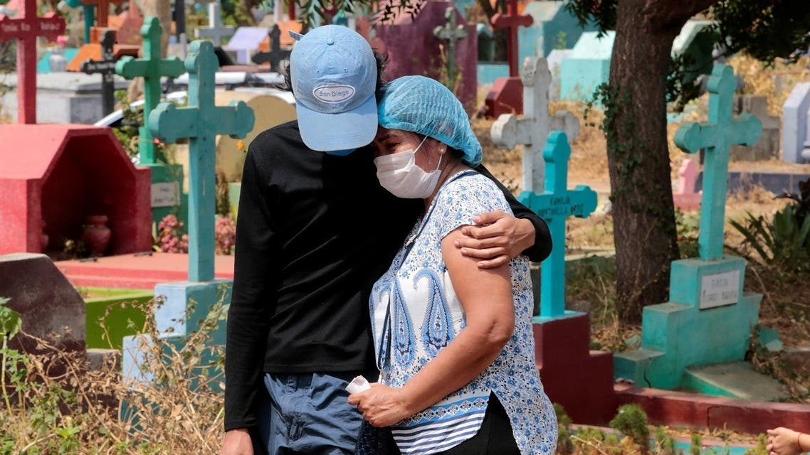 People attend the burial of a man suspected to have died of the coronavirus disease (COVID-19) at the Milagro de Dios cemetery in Managua. (Reuters)
