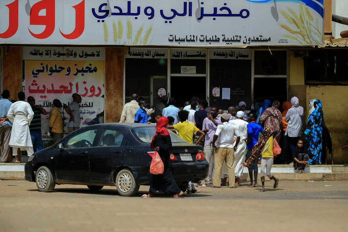 Residents of the Sudanese capital Khartoum queue in front of a bakery, on April 9, 2020. (AFP)