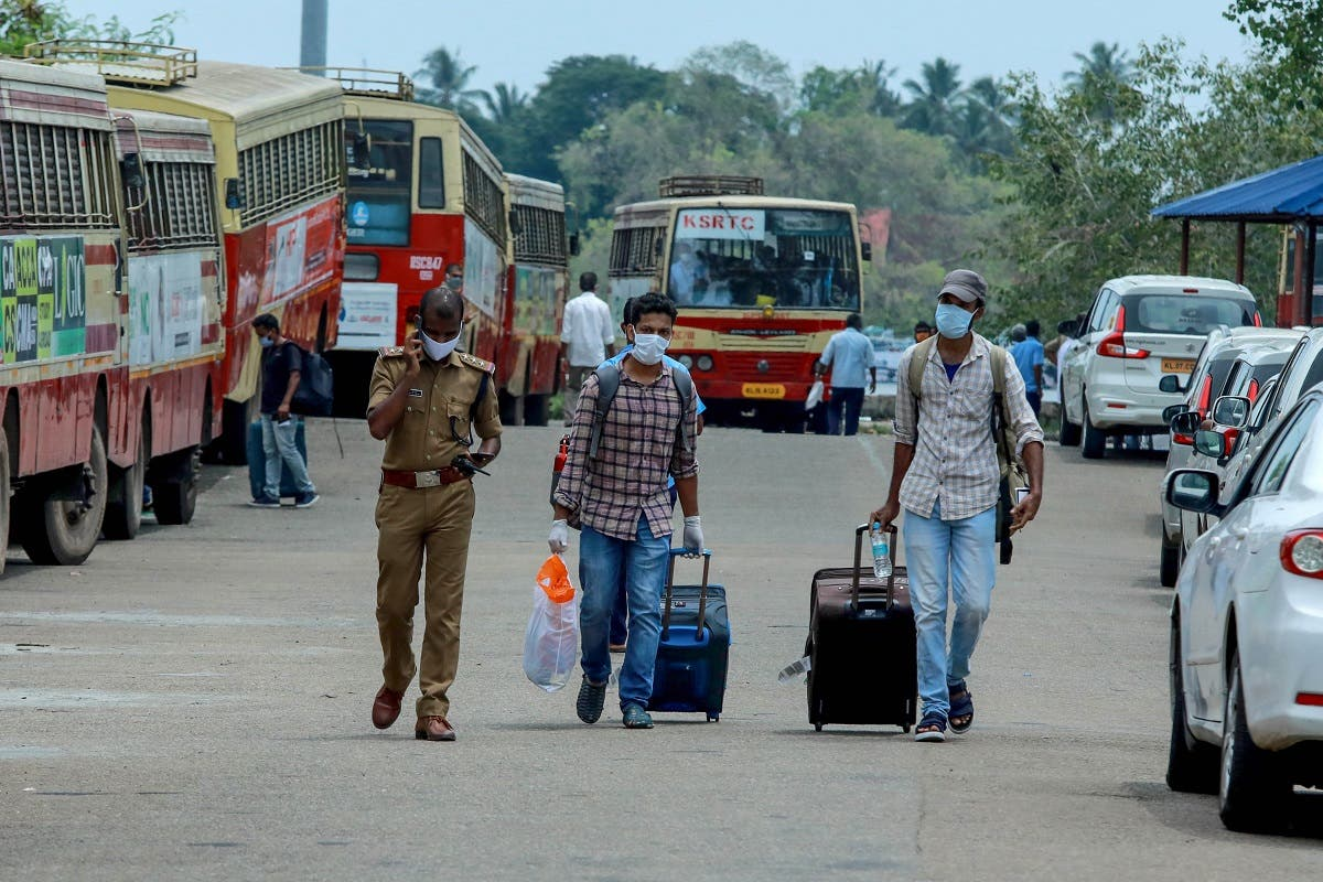Indian citizens evacuated from Maldives with a special ship INS Jalashwa are being shifted to a quarantine center by bus, as part of a massive repatriation effort in Kochi in the south Indian state of Kerala on May 10, 2020. (AFP)