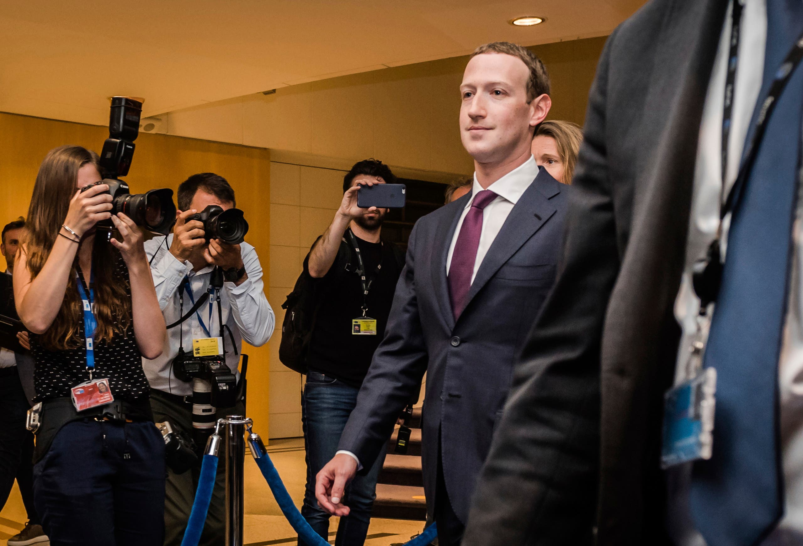 Facebook CEO Mark Zuckerberg leaves the EU Parliament in Brussels during a series of meetings over data protection standards at the internet giant and alleged misuse of the personal information, on May 22, 2018. (File Photo: AP)