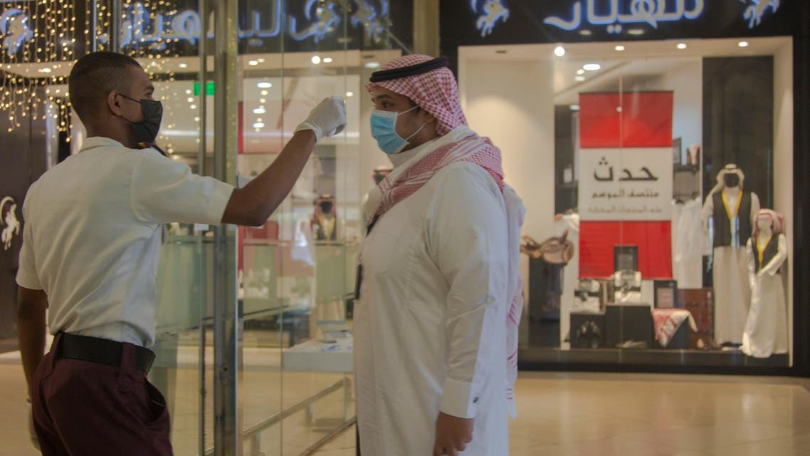 Mall security checks temperature of people visiting a local mall in Medina, Saudi Arabia. (SPA)