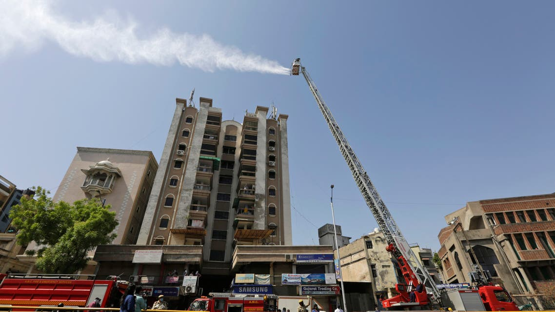 Indian firefighters use a hydraulic platform to sanitize an area during a nationwide lockdown to curb the spread of coronavirus, in Ahmedabad, on Saturday, May 9, 2020. (AP)