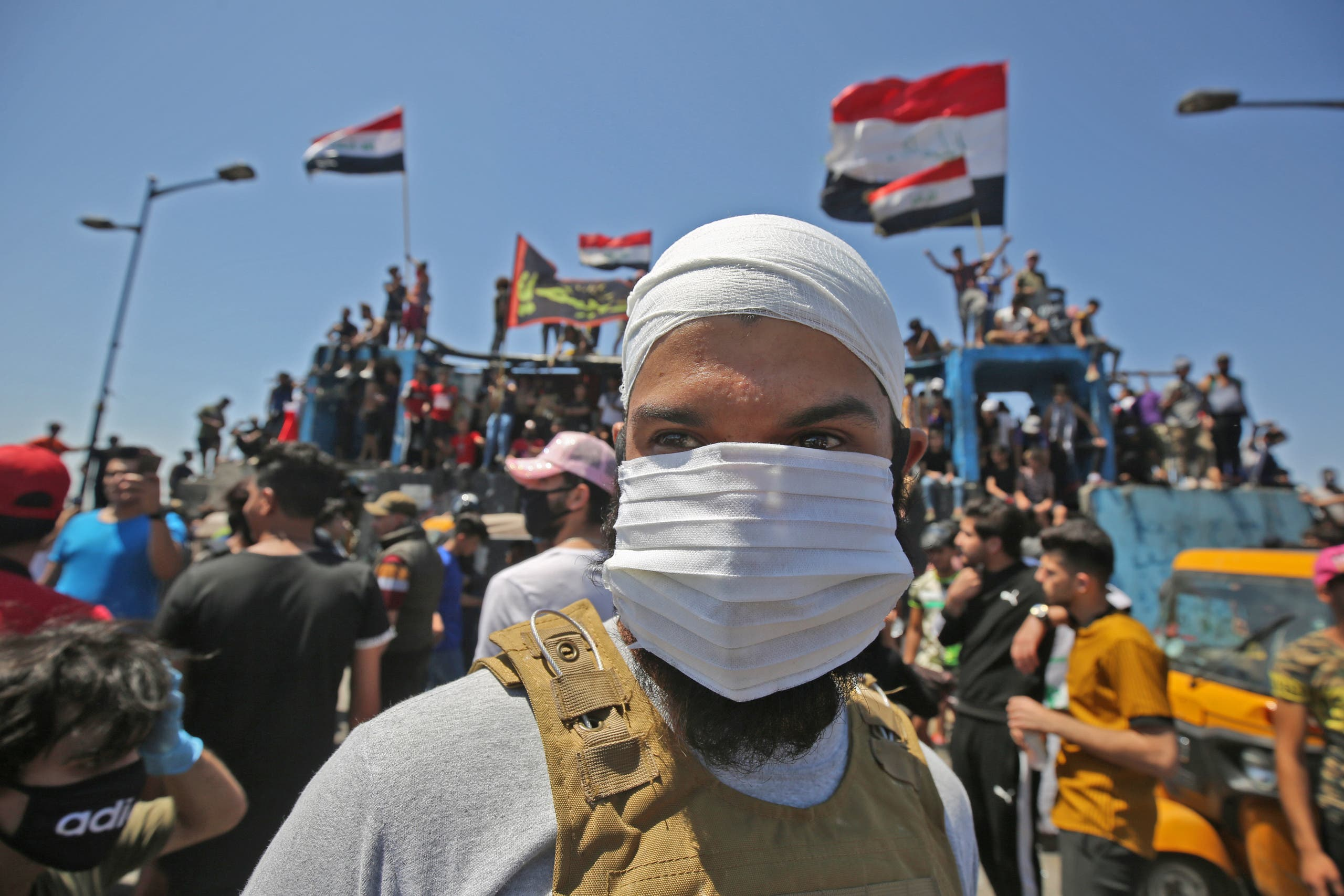 An Iraqi protester wears a face mask during an anti-government demonstration on Al-Jumhuriyah bridge in the capital Baghdad, on May 10, 2020. (File photo: AP)