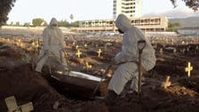 Cemetery workers bury coronavirus victims in Rio