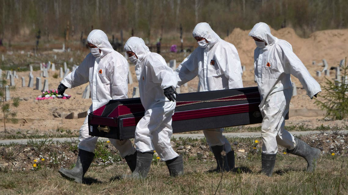 Grave diggers carry a coffin while burying a COVID-19 victim in a cemetery in Kolpino, Russia on May 10, 2020. (AP)
