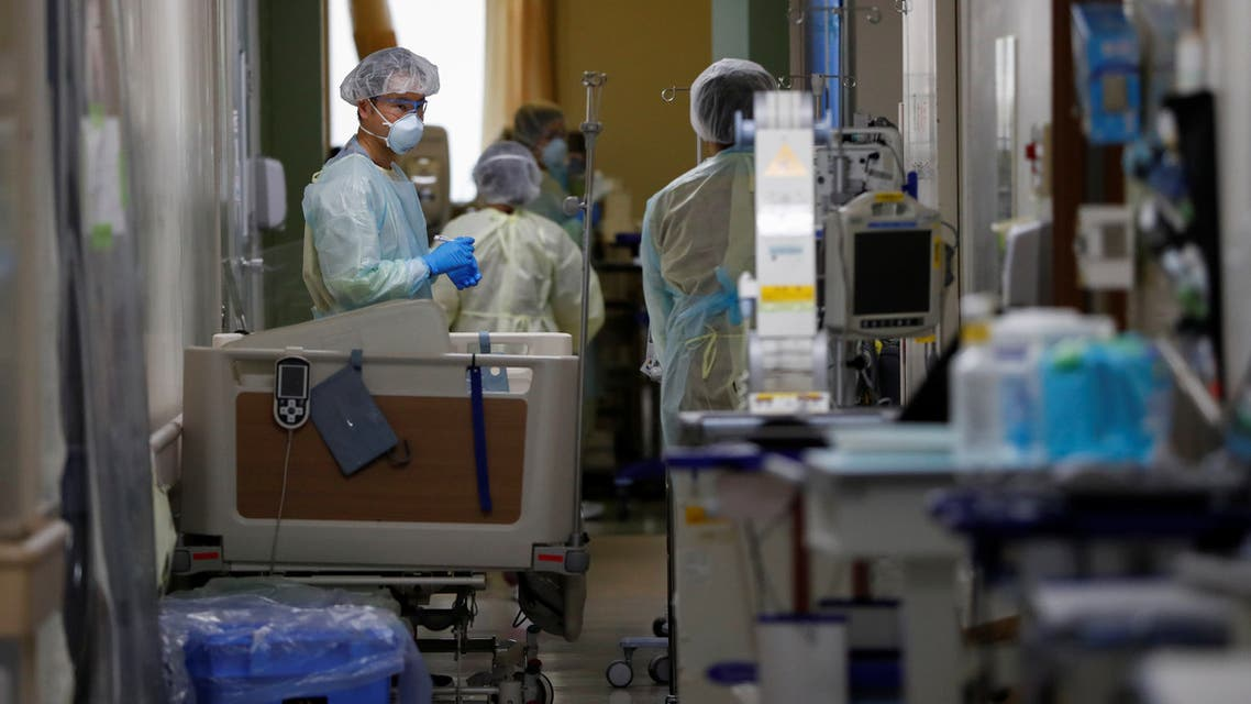 Medical workers wearing personal protective equipment work in the ICU for coronavirus patients at St. Marianna Medical University Hospital in Kawasaki, south of Tokyo, on May 4, 2020. (Reuters)