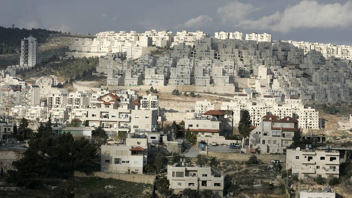 A picture shows housing units (rear of the picture) at at Har Homa Israeli settlement near the West Bank city of Bethlehem. (File photo: AFP)