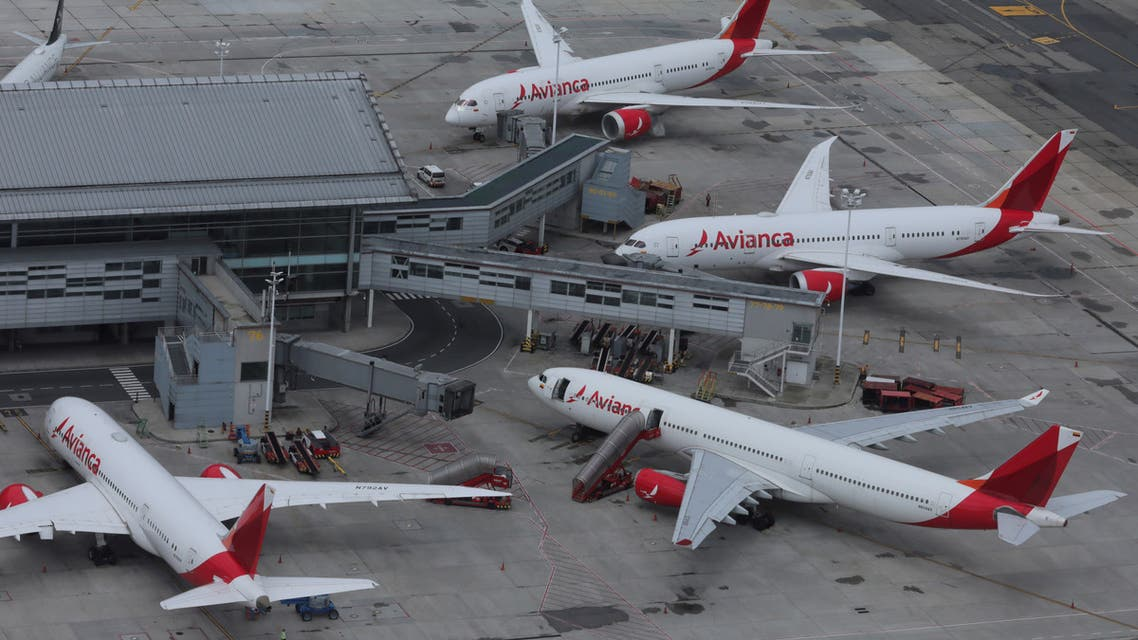 An aerial view shows Colombian airline Avianca's planes parked at El Dorado International Airport amid the coronavirus outbreak in Bogota. (File Photo: Reuters)