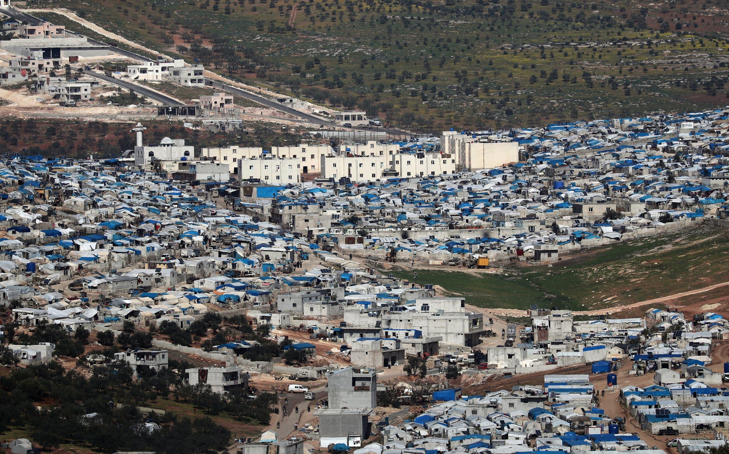 من مخيم عتمة بالقرب من الحدود مع تركيا (أرشيفية)