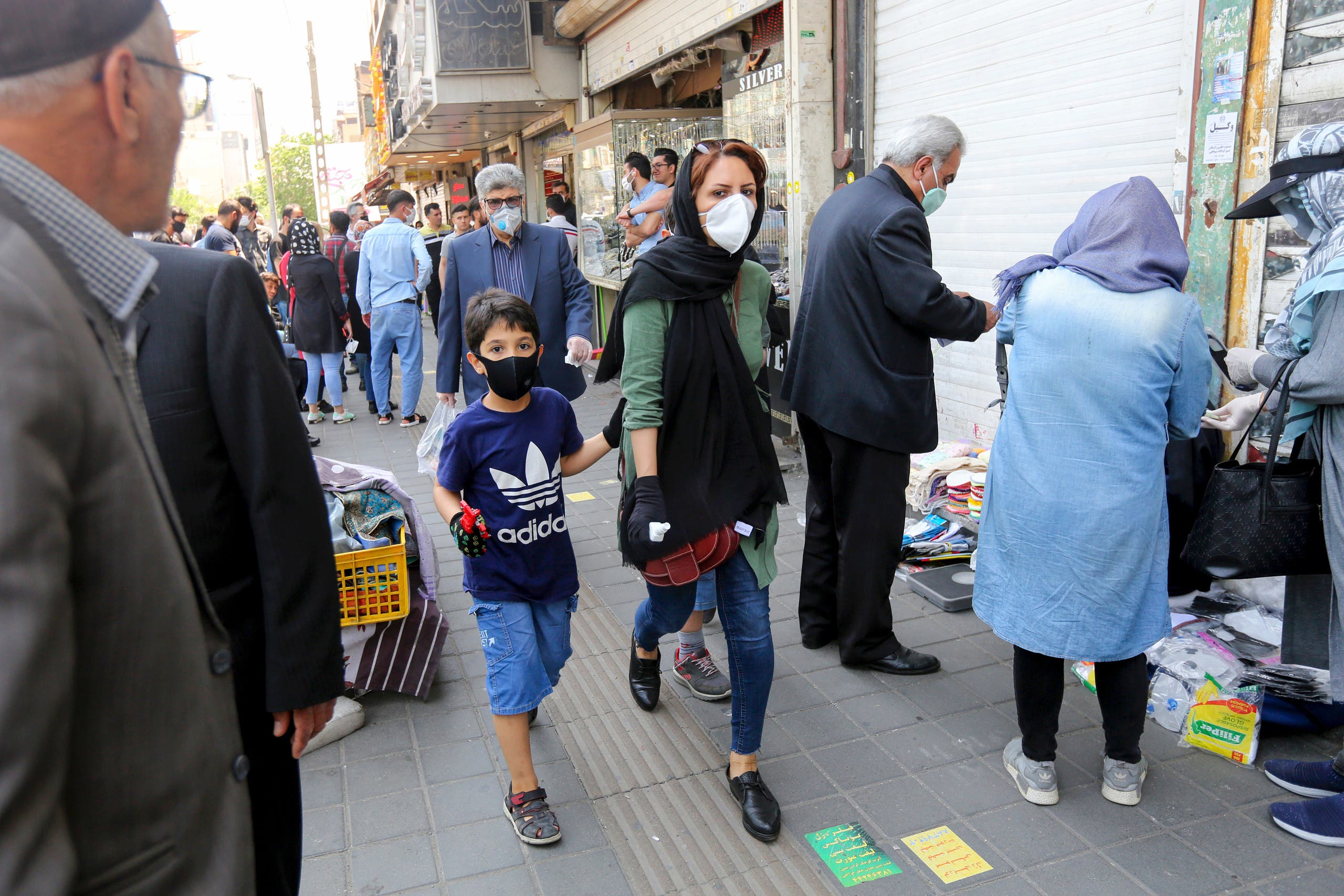 People walking with face masks on the streets of Tehran on May 9, 2020. (AFP)