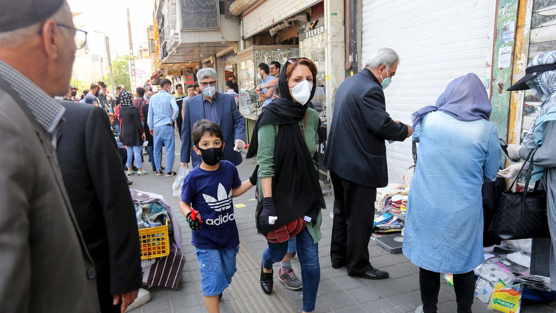 Iranian people walking with face masks in Tehran, May 9, 2020. (File photo, AFP)