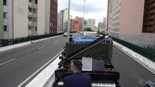 Brazilian musician plays for quarantined mothers on a moving truck