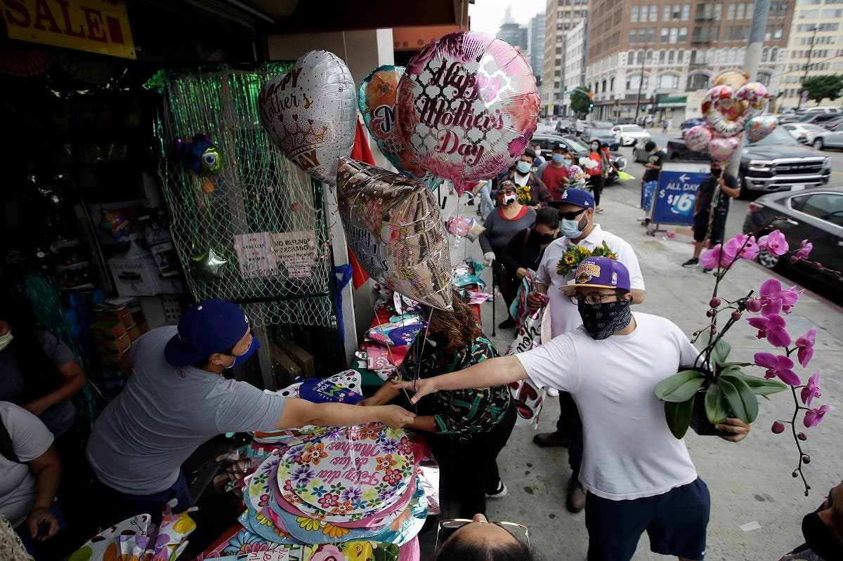 Balloons and flowers are sold on Mother's Day at the Los Angeles Flower Market Sunday, May 10, 2020, in Los Angeles. (AP)