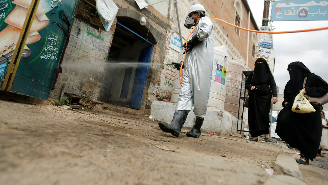 A health worker wearing a protective suit disinfects a market amid concerns of the spread of the coronavirus, in Sanaa, Yemen April 28, 2020. (Reuters)