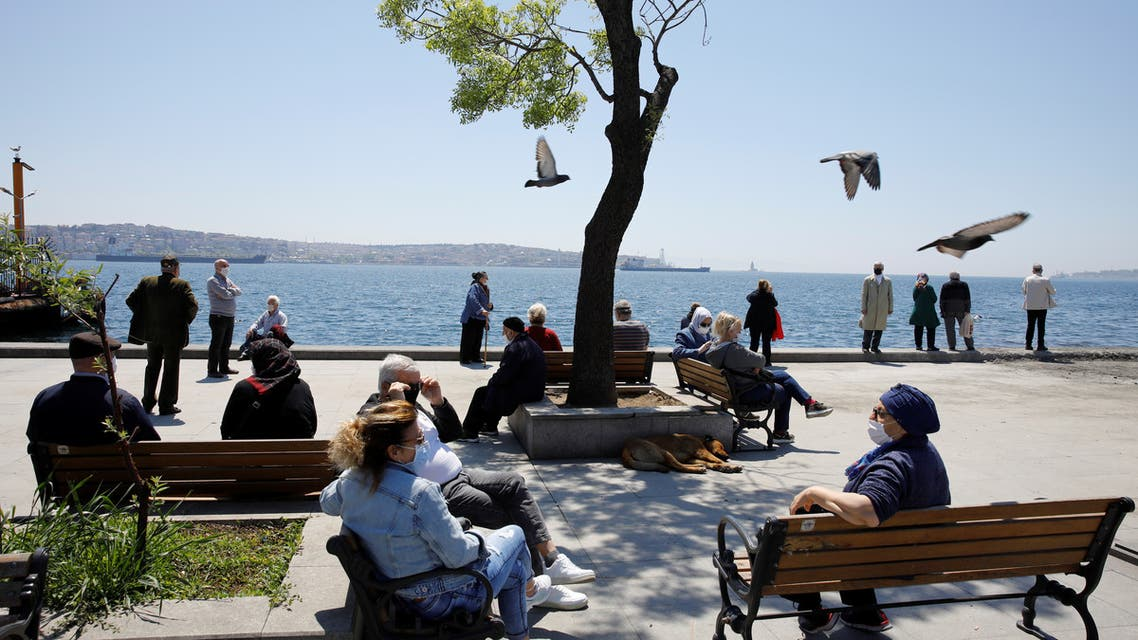 Senior Turkish citizens over 65 years old who are not allowed to go out of their houses since April 4 enjoy a sunny day in a park after being exempted from curfew for 4 hours amid the spread of the coronavirus disease (COVID-19), in Istanbul, Turkey, May 10, 2020. (Reuters)