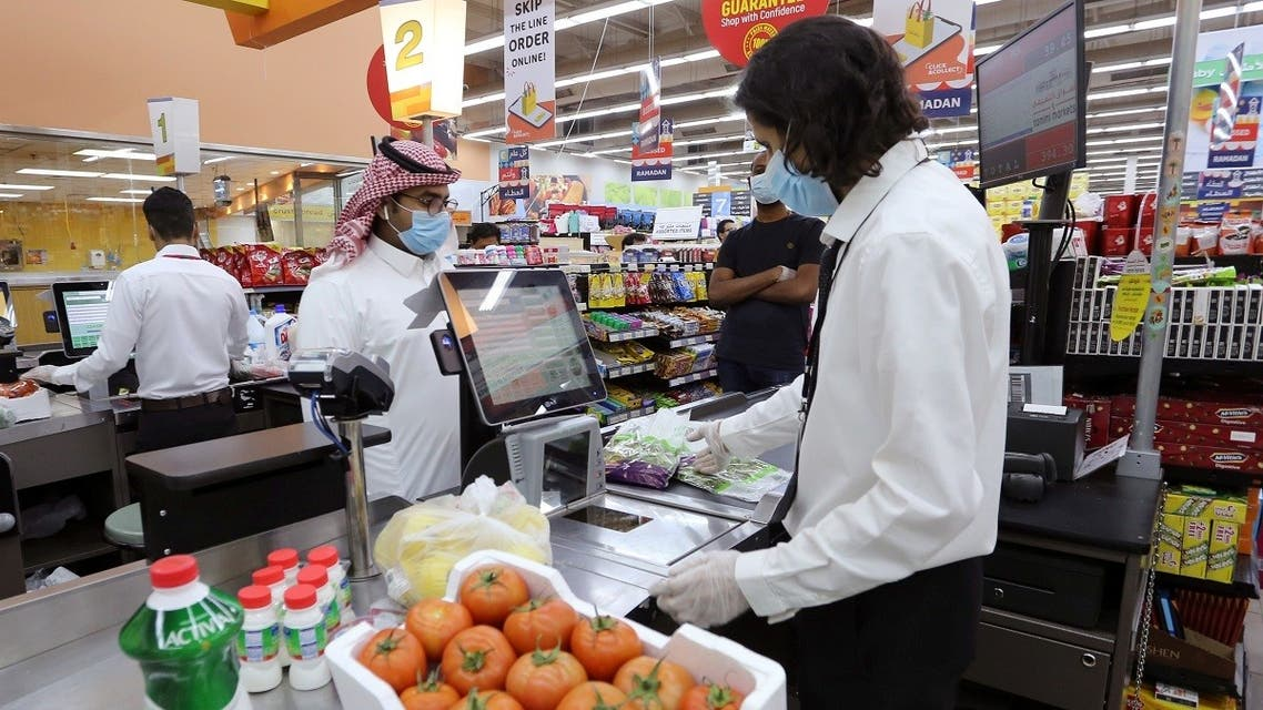People wearing protective face masks and gloves shop at a supermarket, following the outbreak of the coronavirus disease (COVID-19), in Riyadh, Saudi Arabia. (Reuters)