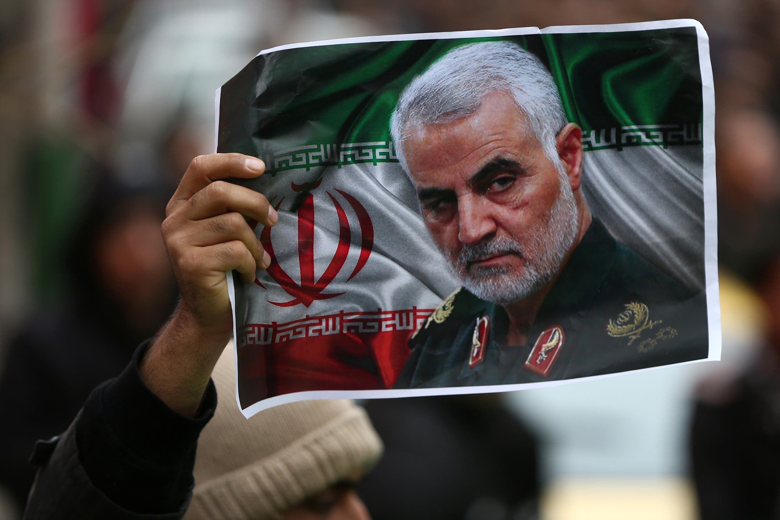 An Iranian holds a picture of late General Qassem Soleimani in Tehran, Iran January 4, 2020. (Reuters)