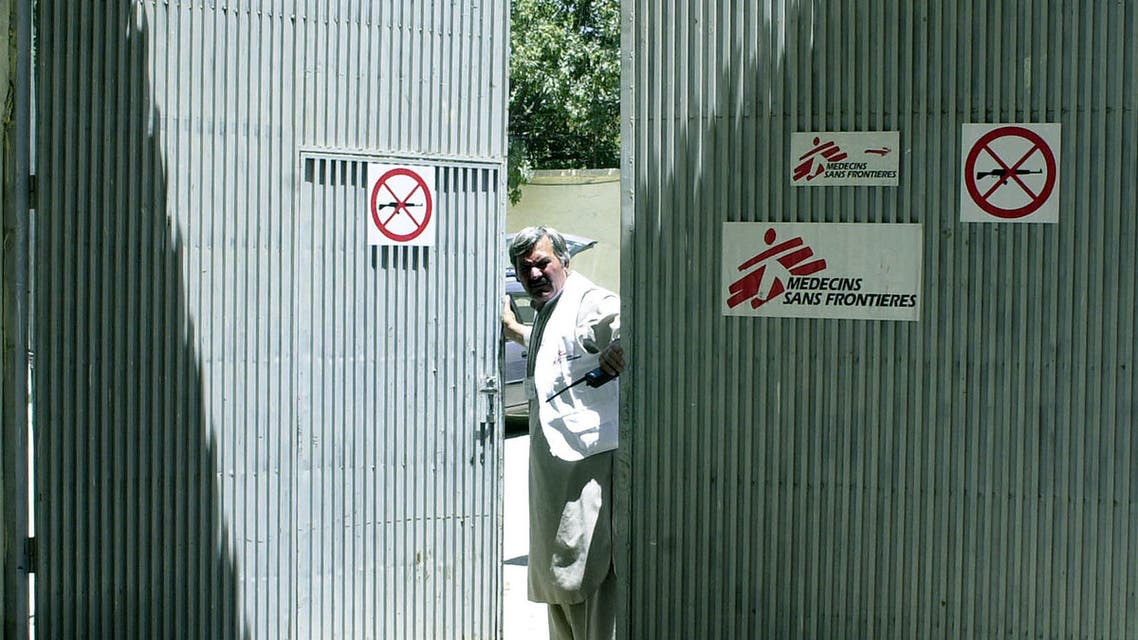 An Afghan security guard looks through the gate of the NGO Medecins Sans Frontieres (Doctors Without Borders) in Kabul. 03 June 2004. (AFP)