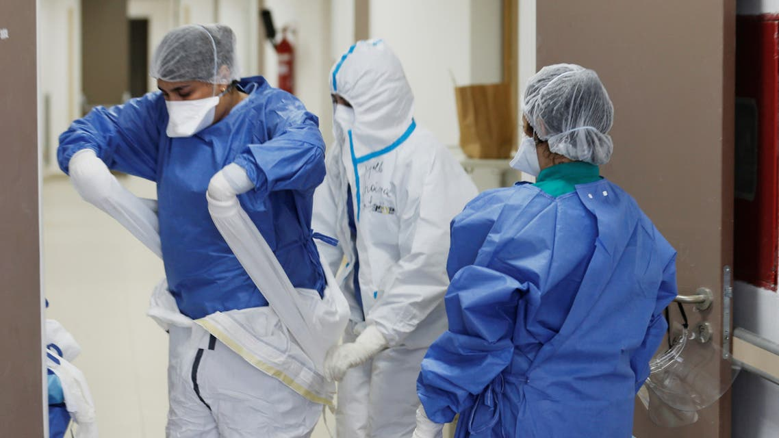 Nurse Chaimaa helps Doctor Meryem Bouchbika to take off her protective gear at Prince Moulay Abdellah hospital as the spread of the coronavirus disease (COVID-19) continues in Sale, Morocco April 22, 2020. Picture taken April 22, 2020. REUTERS/Youssef Boudlal