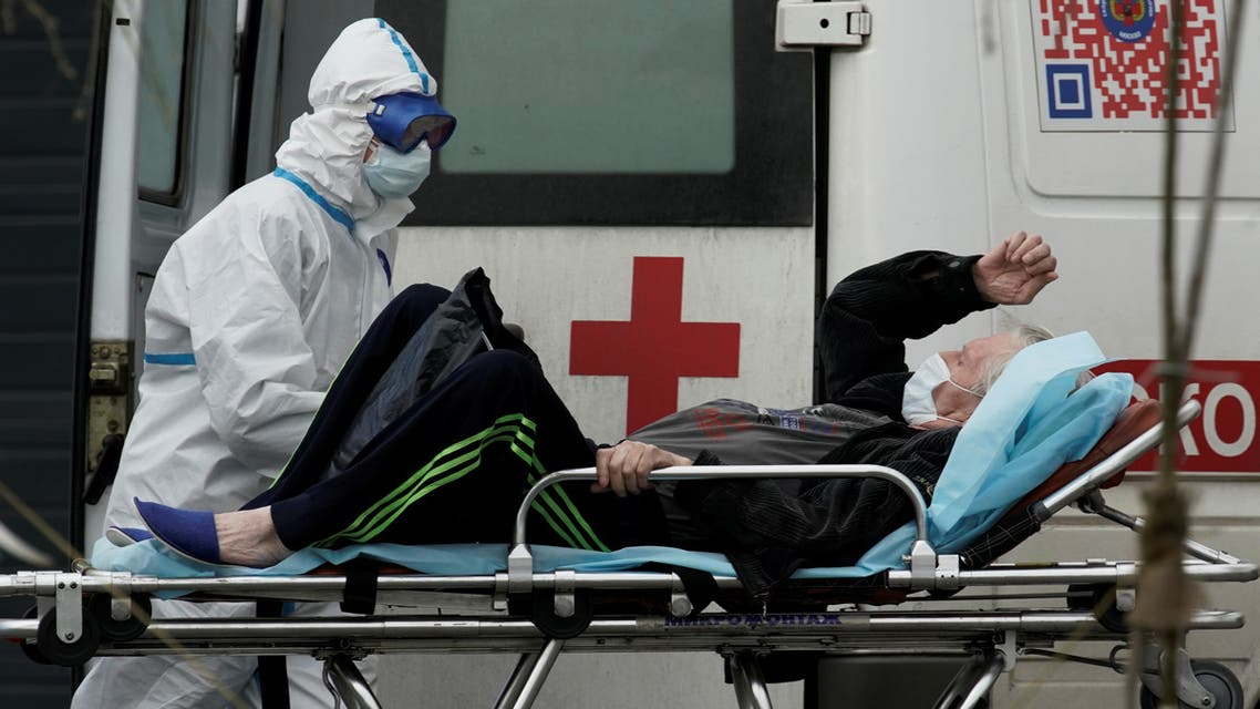 A medical specialist wearing protective gear transports a man on a stretcher outside a hospital for patients infected with the coronavirus on the outskirts of Moscow, Russia, April 29, 2020. (Reuters)