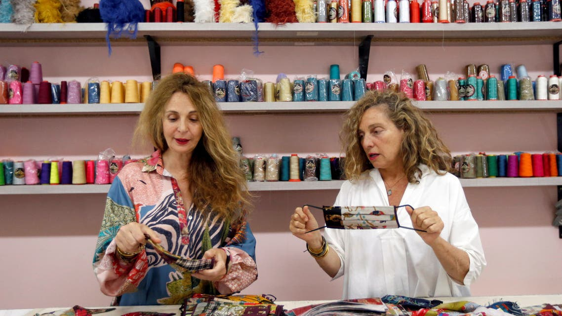 Beirut-based designers Bokja, who now dedicate their time to sewing colorful silk face masks, are seen at an atelier in Beirut, Lebanon, on May 7, 2020. (Reuters)