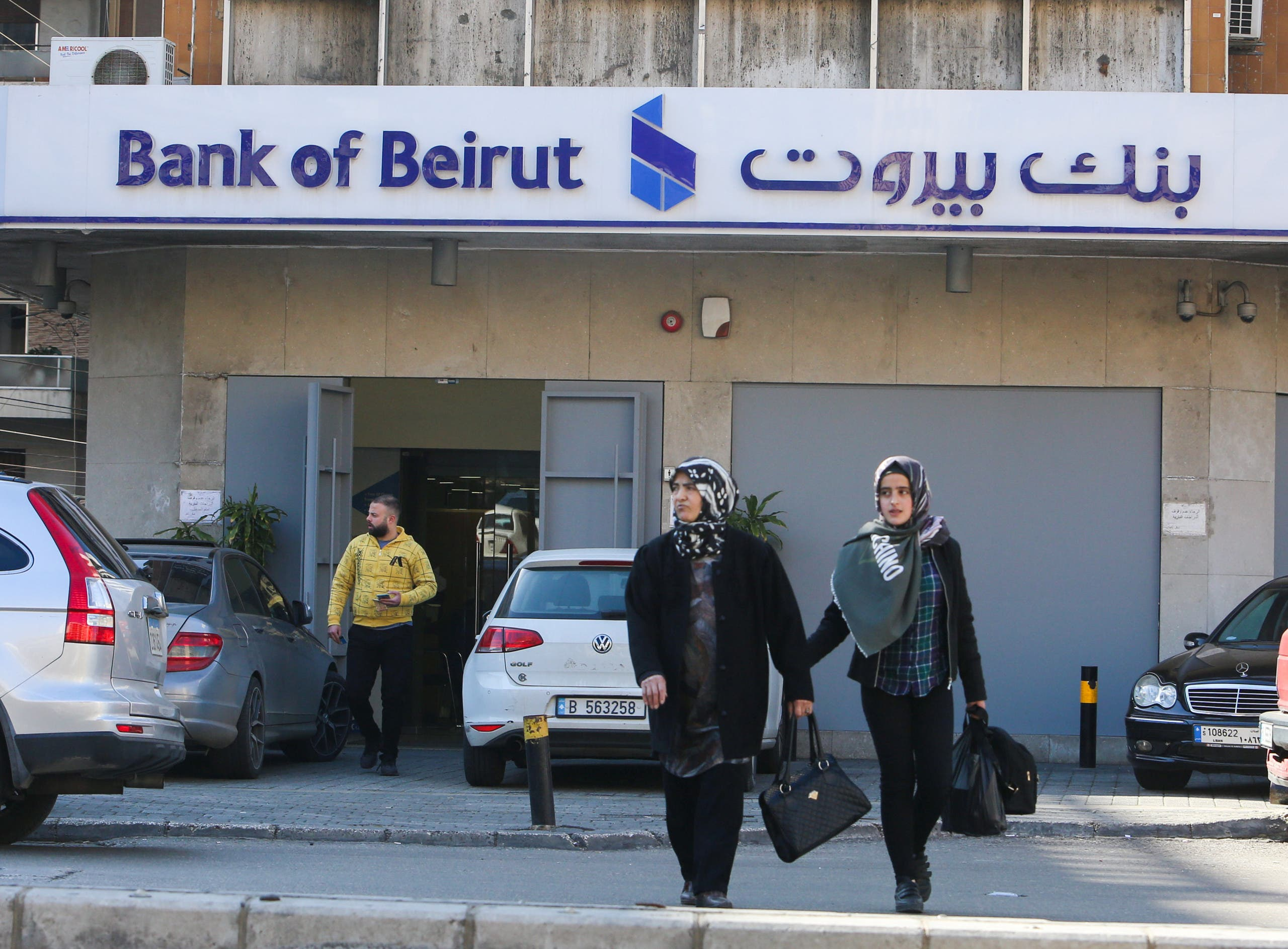 Women walk near a branch of Bank of Beirut, in Beirut, Lebanon, March 2, 2020. Picture taken March 2, 2020. (Reuters)
