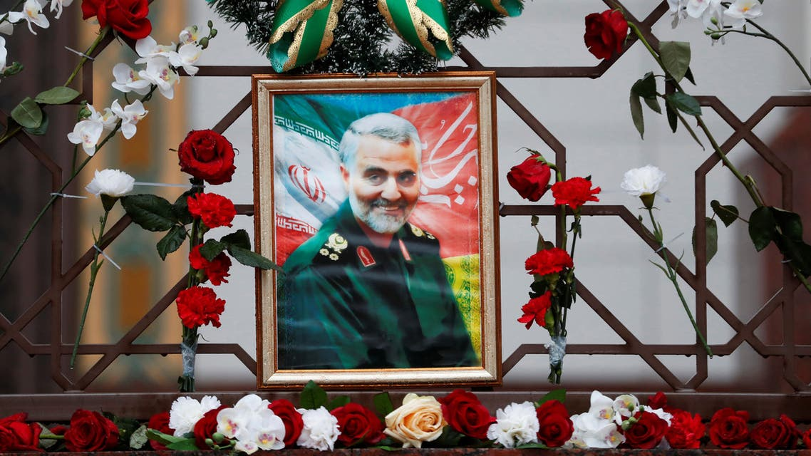 Flowers lie around a portrait of Iranian Major-General Qassem Soleimani, who was killed in an airstrike near Baghdad, at the Iranian embassy's fence in Minsk, Belarus January 10, 2020. (Reuters)