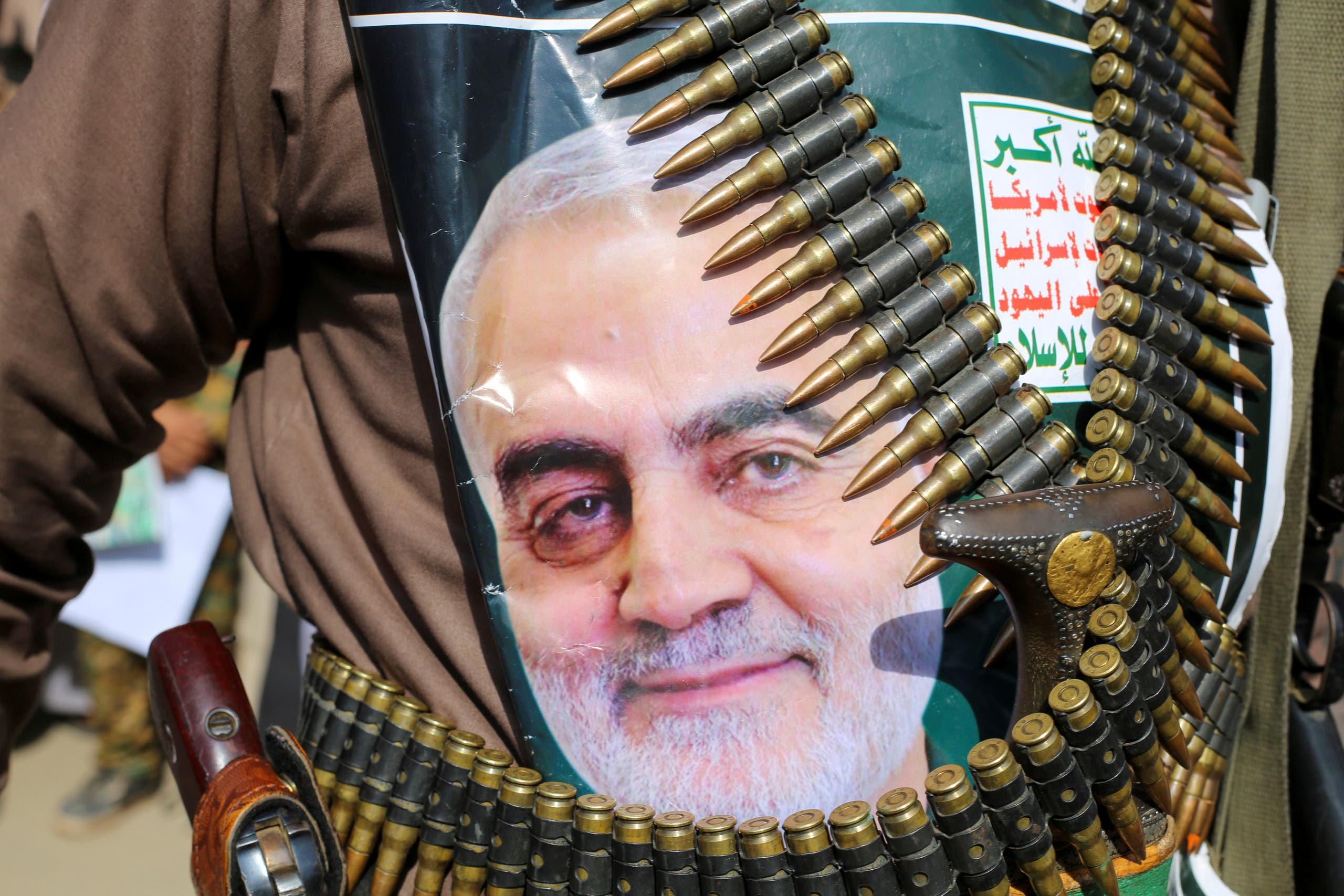 A supporter of the Houthis in Yemen has a poster attached to his waist of Iranian Major-General Qassem Soleimani, head of the Quds Force, who was killed in an air strike at Baghdad airport. The writing on the poster reads: God is the Greatest, Death to America, Death to Israel, Curse on the Jews, Victory to Islam. (Reuters)
