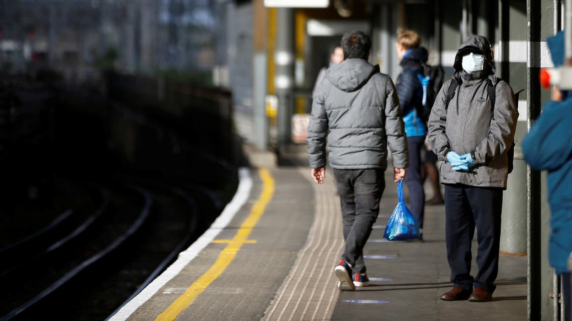 A commuter wears a mask at Canning Town station, following the outbreak of the coronavirus disease (COVID-19), London, Britain. (Reuters)