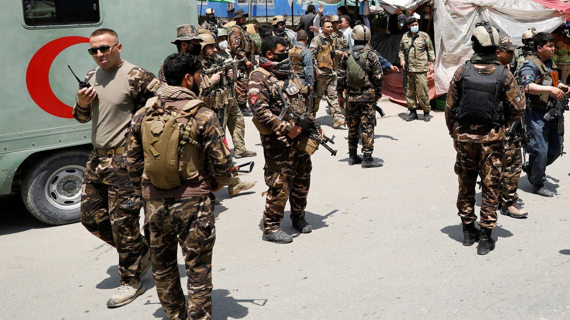 Afghan security forces stand guard outside a hospital which came under attack in Kabul, Afghanistan, on May 12, 2020.  (Reuters)