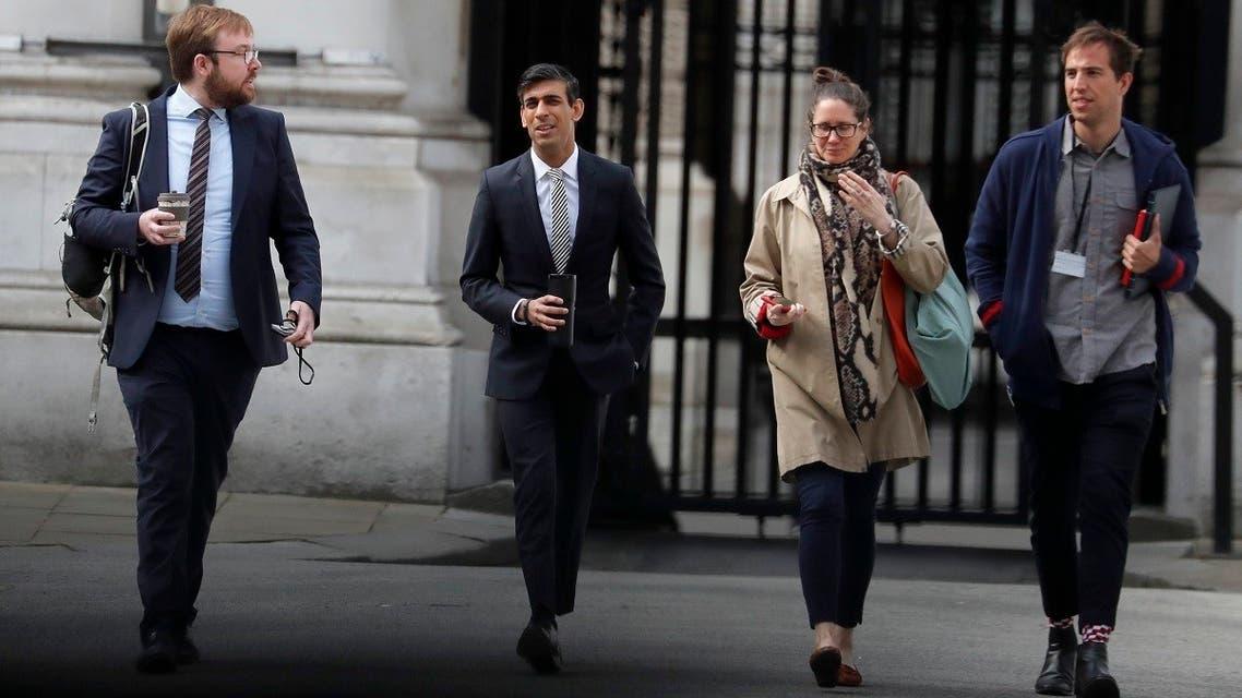 Britain's Chancellor of the Exchequer Rishi Sunak (second left) AP