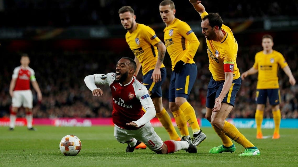 Arsenal's Alexandre Lacazette tries to get past Atletico Madrid defender Diego Godin during the first leg of the Europa League semi-final at the Emirates Stadium in London. (File photo: Reuters)