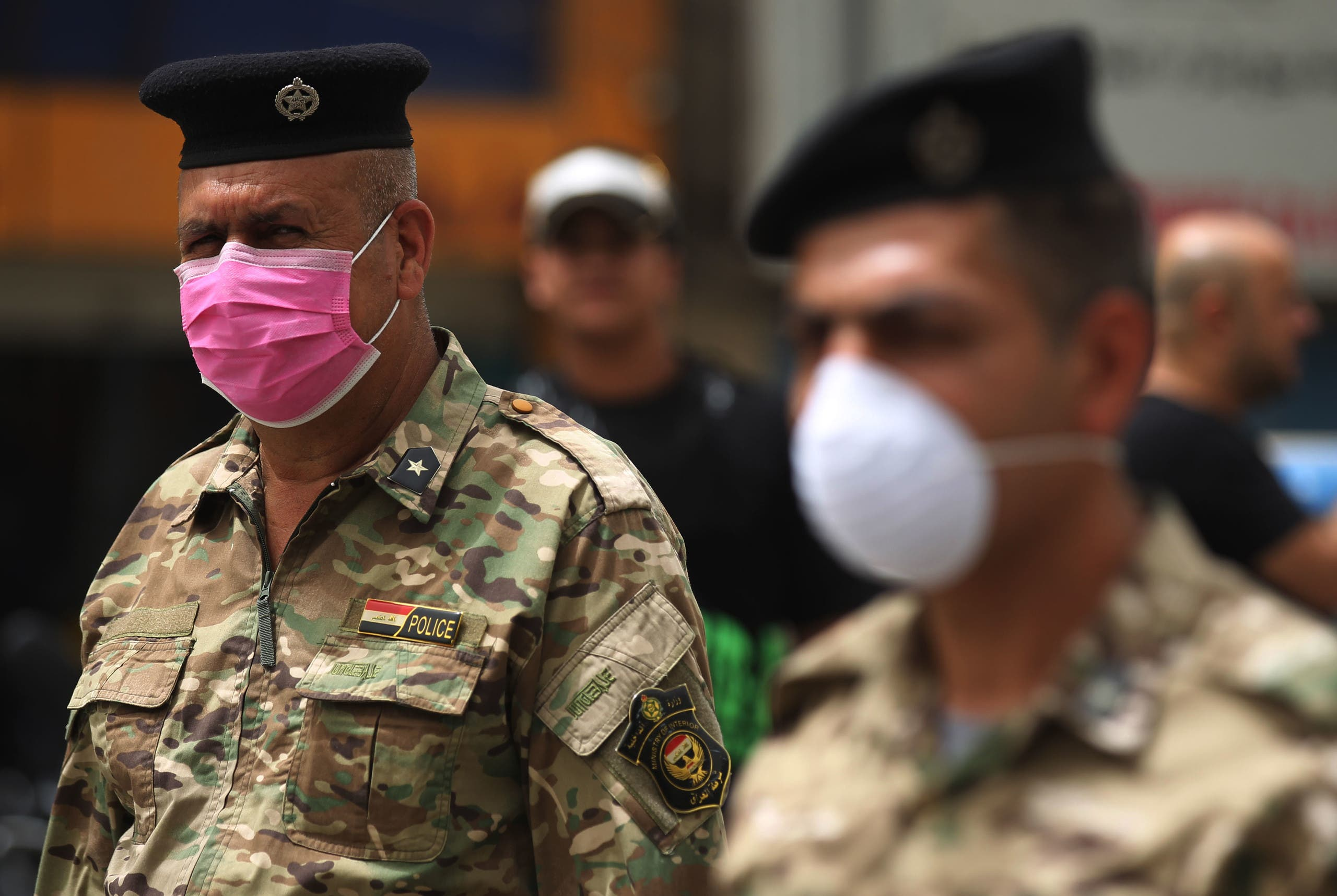Members of the Iraqi security forces wearing protective masks keep watch at Tahrir Square in central Baghdad on May 5, 2020. (AFP)