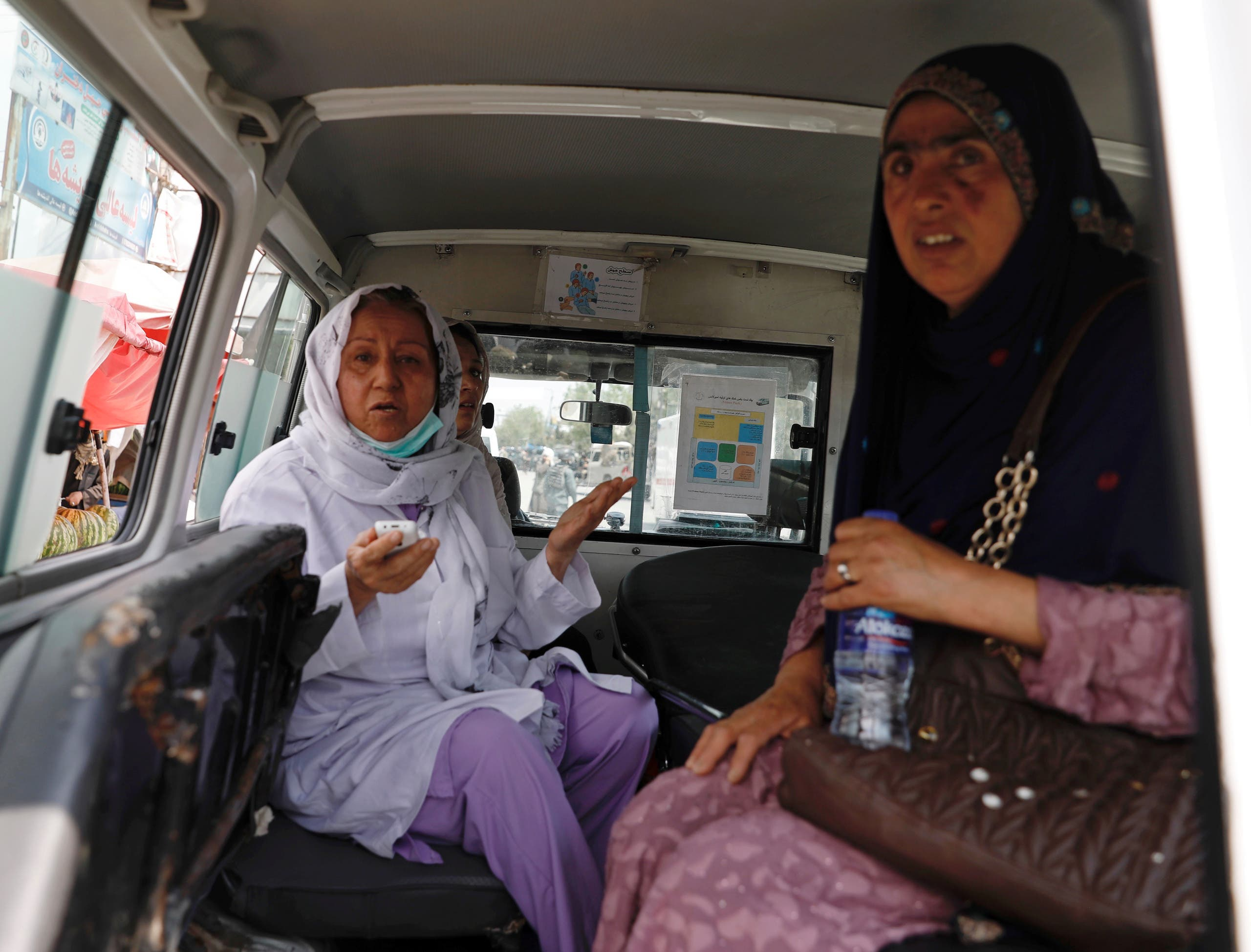 Afghan women sit in an ambulance after being rescued by security forces during an attack and gunfire at a hospital in Kabul, Afghanistan. (Reuters)