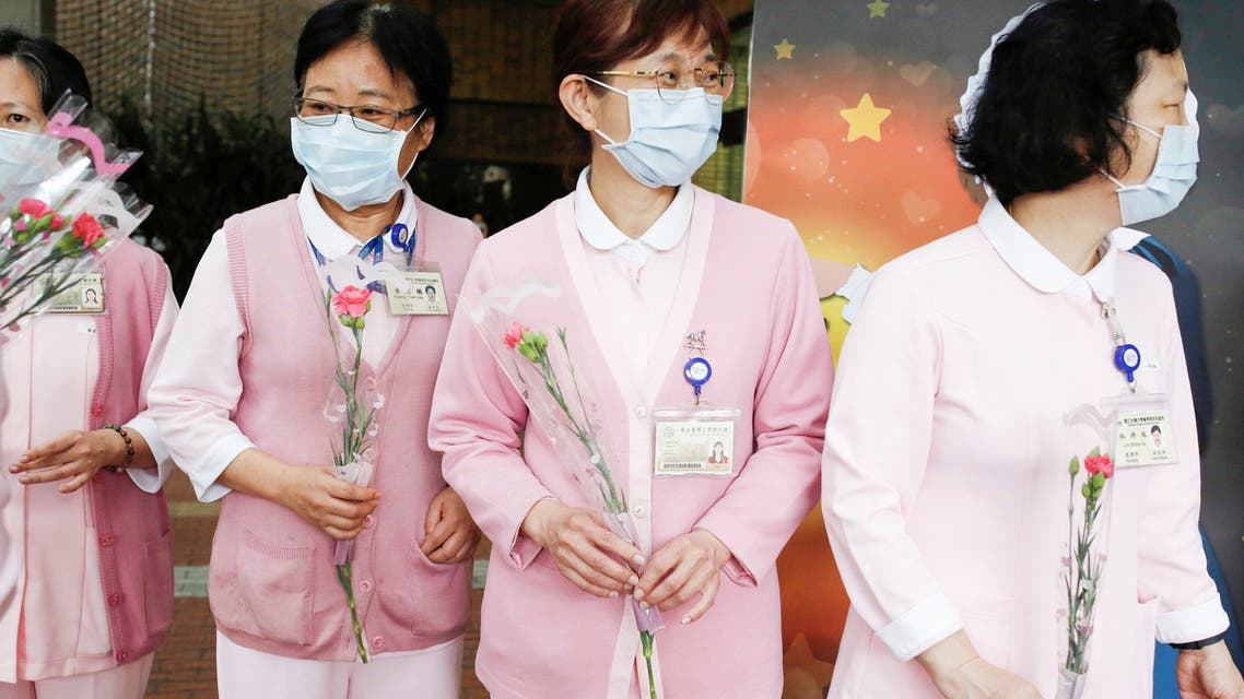 Nurses receive flowers to celebrate the International Nurse day in Taipei, Taiwan, May 12, 2020. REUTERS/Ann Wang