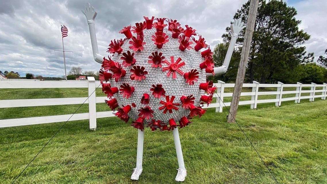 A sculpture in the likeness of a coronavirus particle is seen outside a property that borders a road leading to St. Michaels, Maryland, amid the coronavirus disease (COVID-19) outbreak in the US, April 27, 2020. (Reuters)