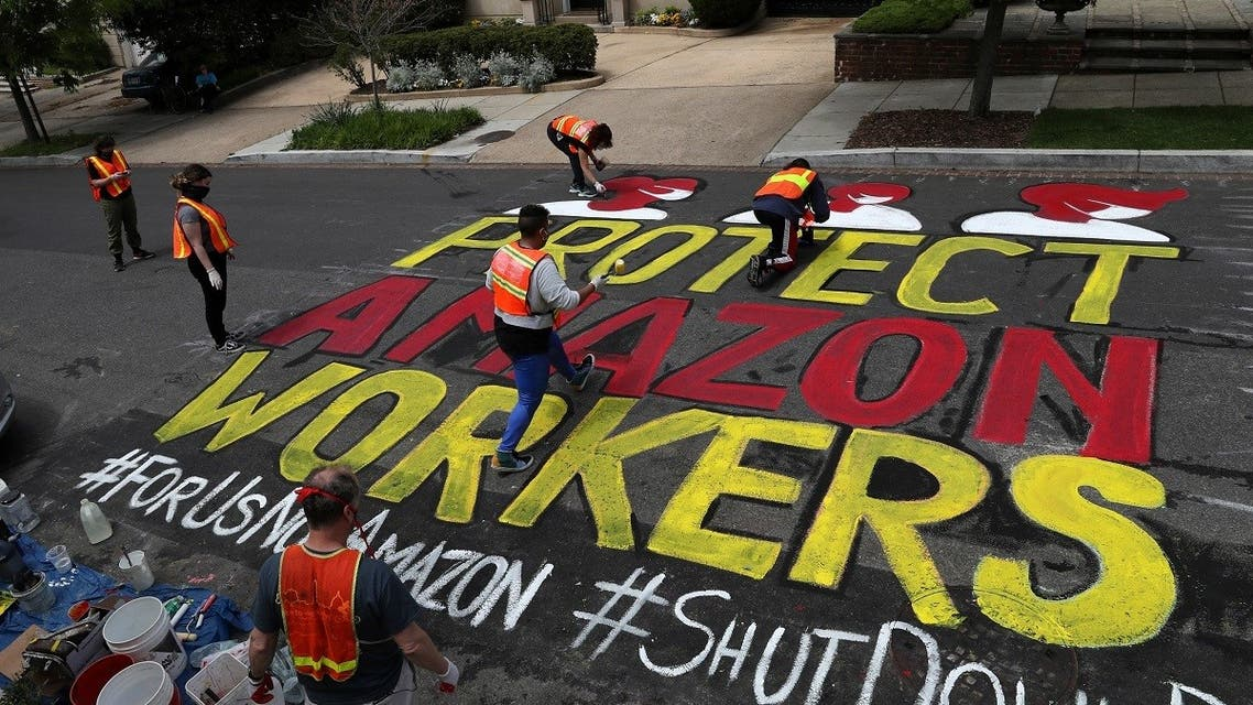A message is painted by activists on the street outside of one of the personal residences of Amazon founder Jeff Bezos during the outbreak of the coronavirus disease in Washington, US, April 29, 2020. (Reuters)
