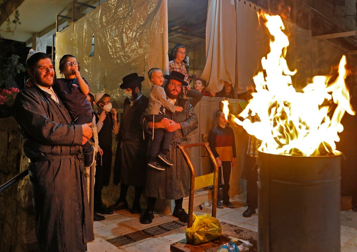Ultra-Orthodox Jews light a Lag BaOmer bonfire in Jerusalem's religious Mea Shearim neighborhood amid an Israeli order to maintain social distancing and to cancel all holiday celebrations, on May 11, 2020. (AFP)