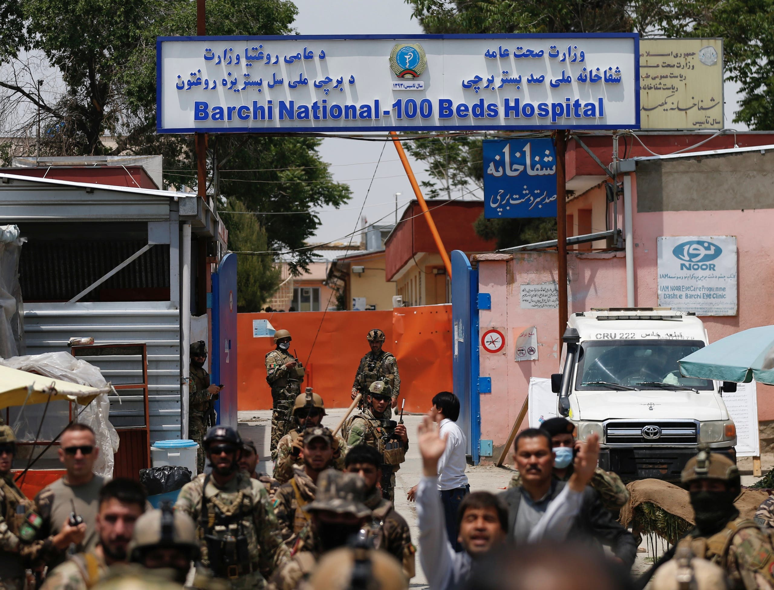 Afghan security forces stand guard outside Dasht-e-Barchi Hospital which came under attack in Kabul, on May 12, 2020.  (Reuters)