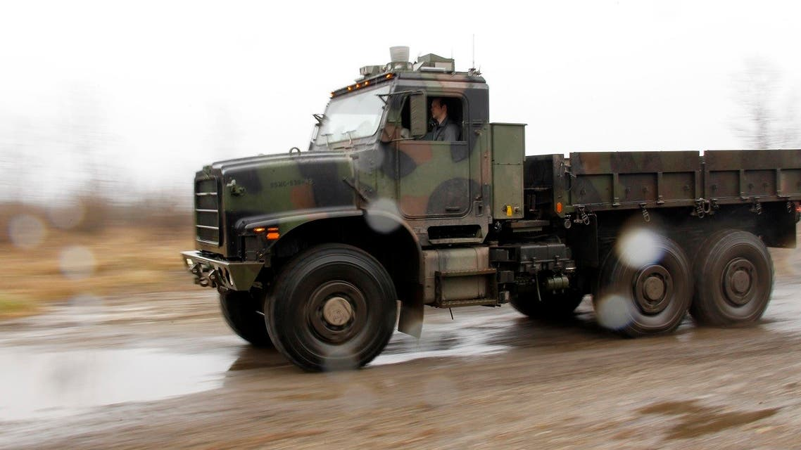 An Oshkosh truck using the TerraMax autonomous driving system drives along a test course outside of Pittsburgh, Pennsylvania, March 1, 2012. The robotic truck is being developed by Oshkosh and its partners for the U.S. military. (Reuters)