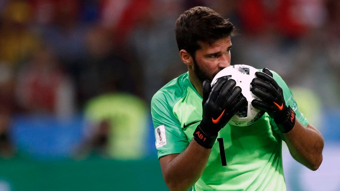 In this June 27, 2018 file photo, Brazil goalkeeper Alisson kisses the ball after makes a save during their World Cup soccer match against Serbia. (AP)