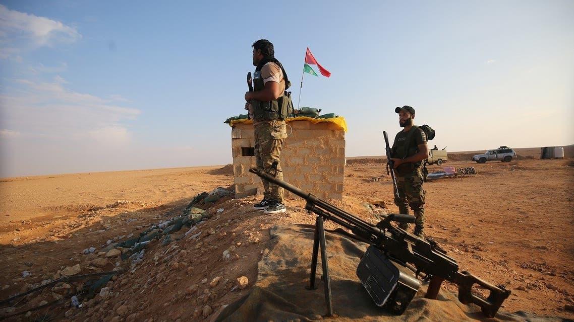 Iraqi Shia fighters of the PMU militias secure the border in al-Qaim in the Anbar province, opposite Albukamal in Syria's Deir Ezzor region. (File photo: AFP)