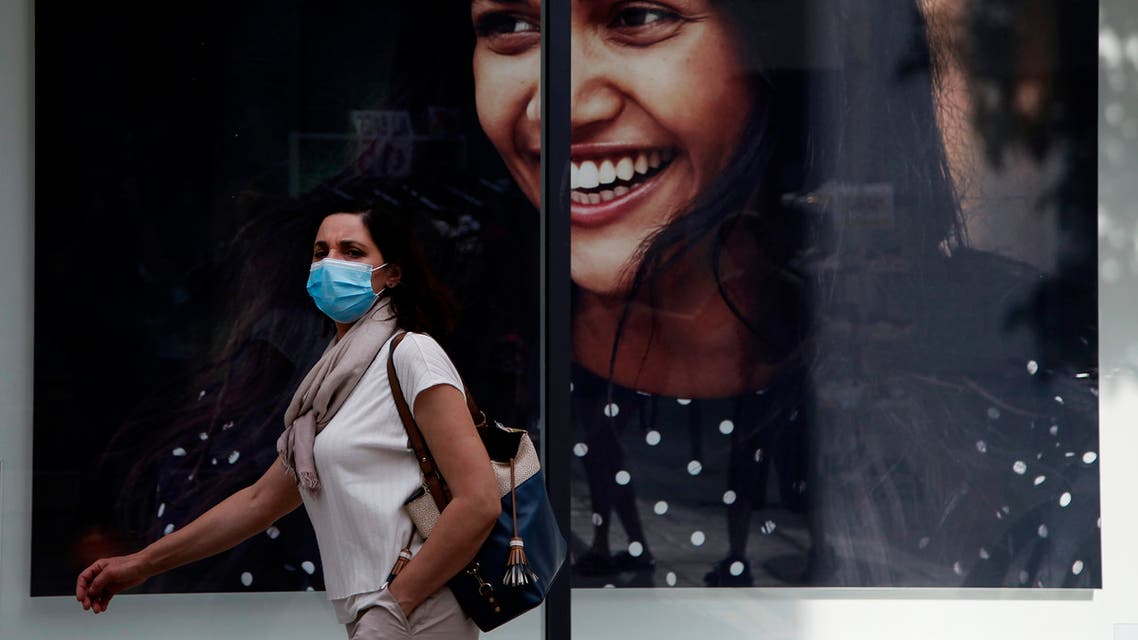 A woman wearing a mask walks along Ledra Street, a busy shopping thoroughfare in the medieval center of capital Nicosia, Cyprus, on Thursday, May 7, 2020. (File photo: AP)