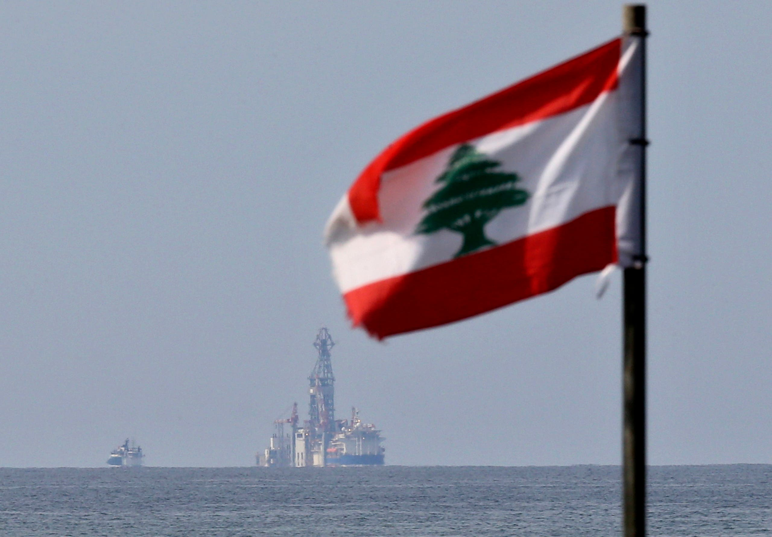 A Lebanese flag flutters in the wind as the drilling ship Tungsten Explorer is seen off the coast of Beirut. (File photo: AP)