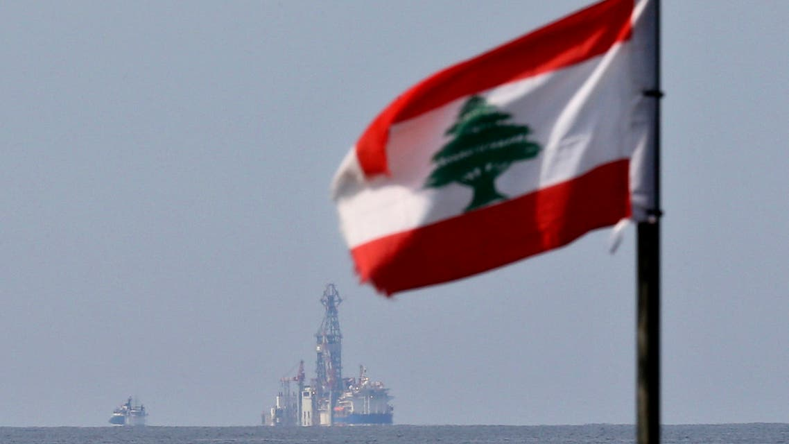 A Lebanese flag flutters in the wind as the drilling ship Tungsten Explorer is seen off the coast of Beirut, Lebanon, Thursday, Feb. 27, 2020. (AP)